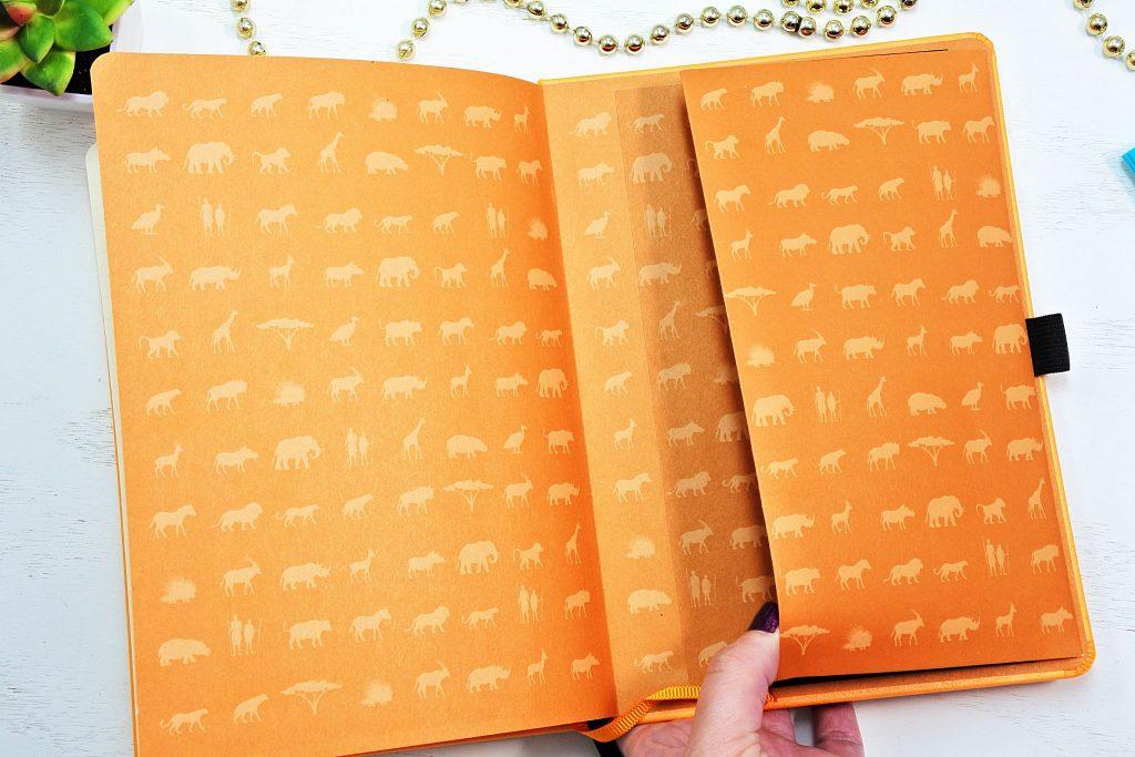 Dingbats dot grid notebook with large back pocket