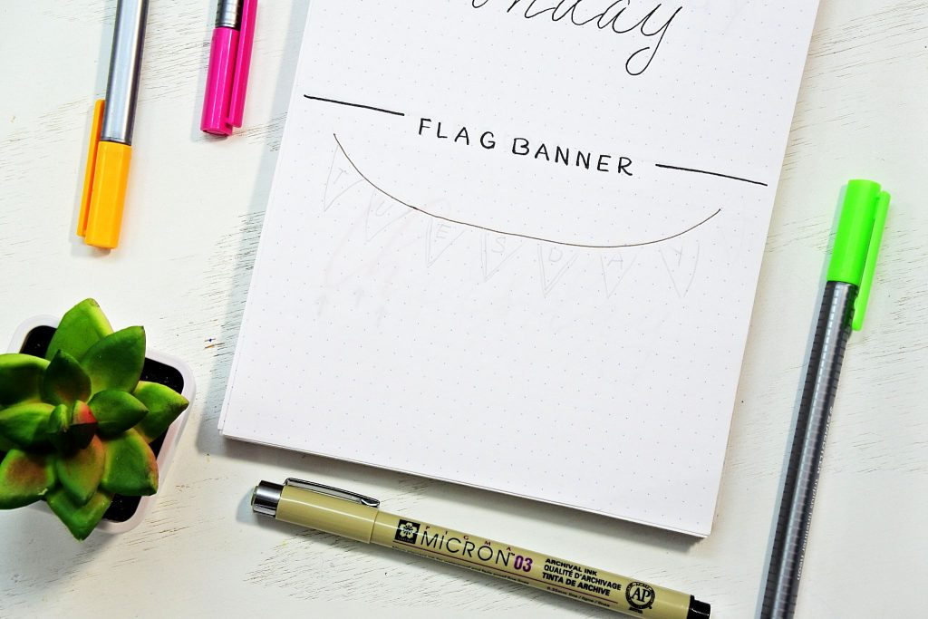 Tutorial for creating a flag banner plus dozens more bullet journal fonts.